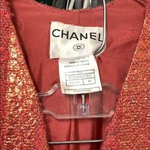 coral colored Chanel suit. Taylored  to a size 2